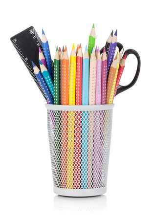 pencil holder: Various colour pencils with ruler and scissors. Isolated on white background Stock Photo