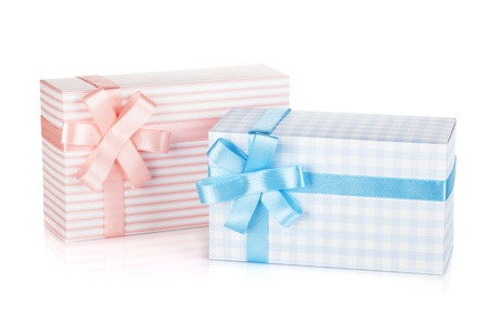 Two gift boxes with ribbon and bow. Isolated on white background Stock Photo - 16901963
