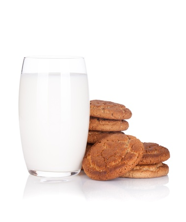 milk and cookies: Glass of milk and cookies. Isolated on white background Stock Photo