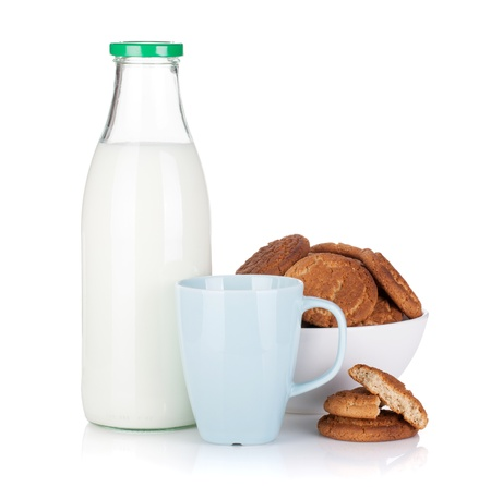 Cup, bottle of milk and bowl with cookies. Isolated on white background photo