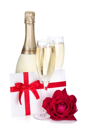 birthday champagne: Two champagne glasses, letter and rose. Isolated on white background