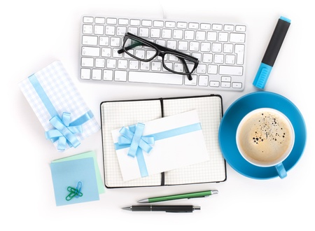 Coffee, office supplies and gifts. View from above. Closeup on white photo