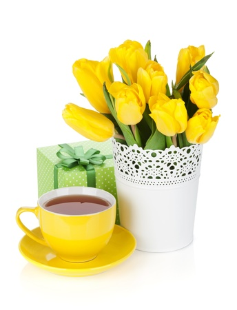 Yellow tulips, tea cup and gift box. Isolated on white background photo