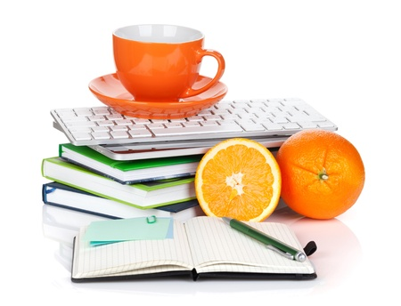 Orange fruits, coffee cup and office supplies. Isolated on white background photo