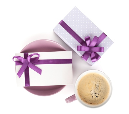 Violet coffee cup, gift box and love letter with bow. View from above. Isolated on white background photo
