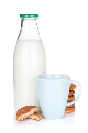 Cup, bottle of milk and cookies. Isolated on white background photo