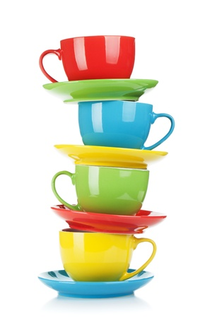 Set of colorful cups. Isolated on white background photo