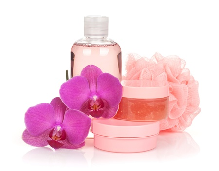 Cosmetics and orchid flowers. Isolated on white background photo