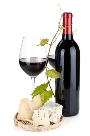Red wine bottle, glasses and cheese. Isolated on white background photo