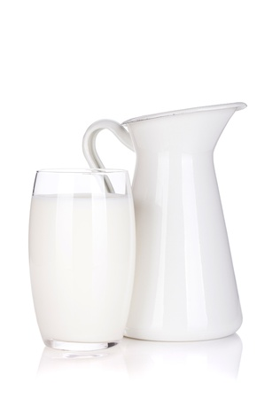 milk jug: Milk jug and glass. Isolated on white background Stock Photo
