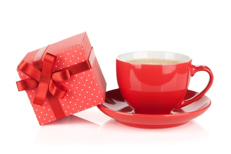 Red coffee cup and gift box with bow. Isolated on white background photo