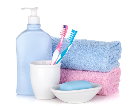 Personal Care: Toothbrushes, gel, soap and two towels. Isolated on white background Stock Photo