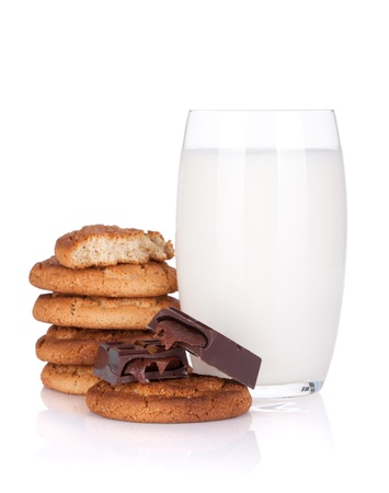 Glass of milk, cookies and chocolate. Isolated on white background photo