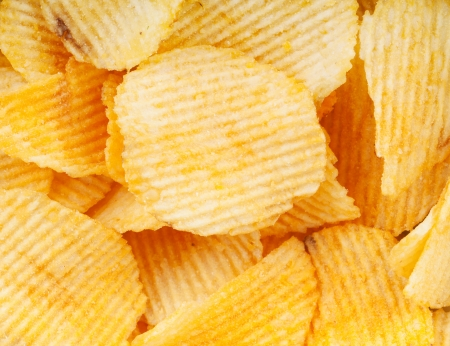 Heap of potato chips closeup Stock Photo - 18375497