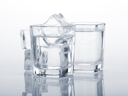 alcoholic drink: Vodka shots with ice cubes. Blue toned