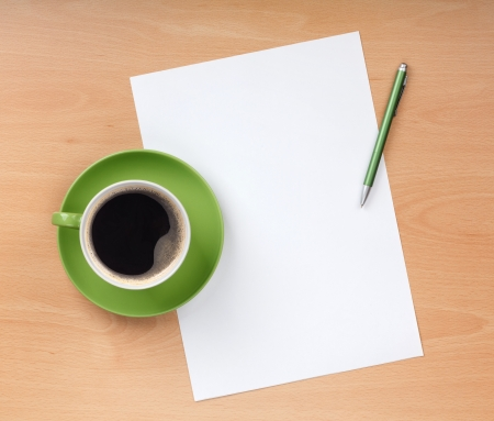 books on a wooden surface: Blank paper with pen and coffee cup on wood table Stock Photo