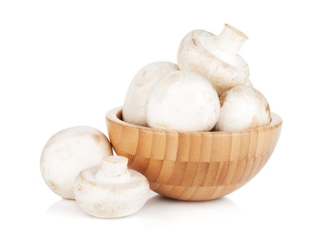 champignon: Bowl with champignon mushrooms. Isolated on white background