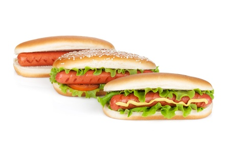 Three hot dogs with various ingredients  Isolated on white background photo