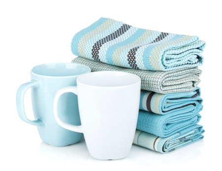 Kitchen towels and tea cups. Isolated on white background photo