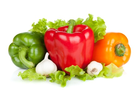 capsicums: Colorful bell peppers with garlic and lettuce. Isolated on white background