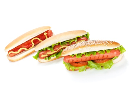 hot sauce: Three hot dogs with various ingredients. Isolated on white background