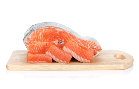Raw salmon on cutting board. Isolated on white background photo