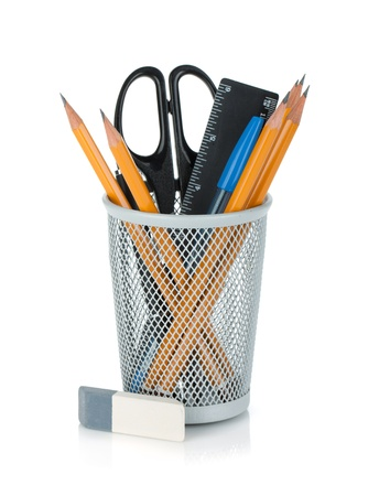 pencil holder: Pencils, pens, ruler, scissors and rubber. Isolated on white background