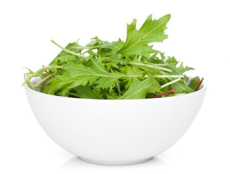 rocket lettuce: Fresh green salad in a bowl. Isolated on white background Stock Photo