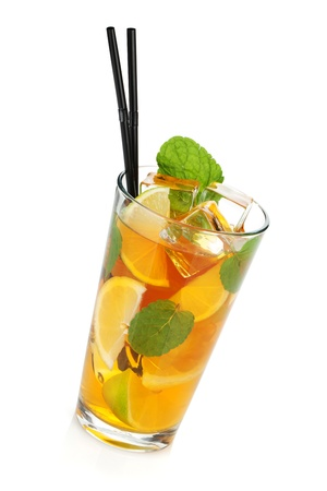 Glass of ice tea with lemon, lime and mint. Isolated on white background Stock Photo