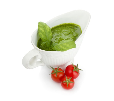 Pesto sauce and cherry tomatoes. Isolated on white background