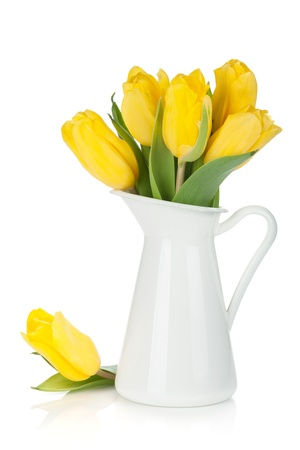 tulips in vase: Yellow tulips in a jug  Isolated on white background