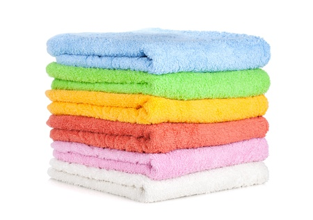 Colored towels. Isolated on white background photo