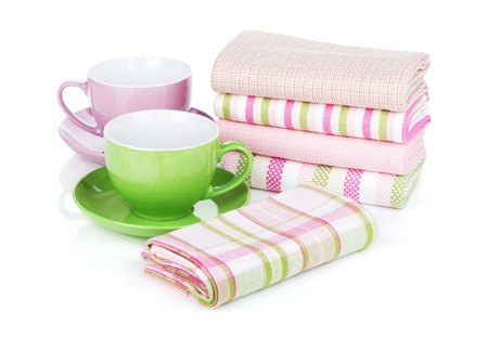 Kitchen towels and coffee cups. Isolated on white background photo