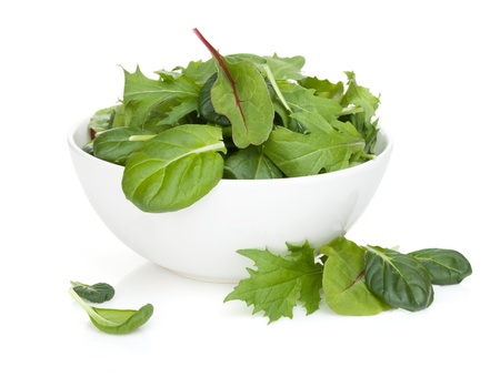 romaine: Fresh green salad in a bowl. Isolated on white background Stock Photo