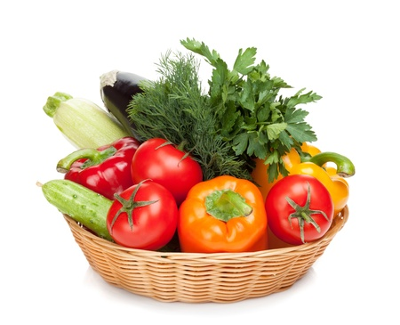 Fresh ripe vegetables in basket. Isolated on white background photo