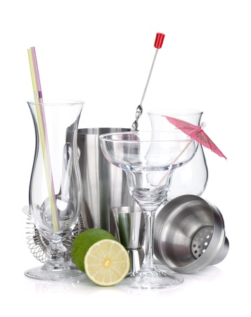 bar tool: Cocktail shakers, glasses, utensils and lime. Isolated on white background Stock Photo