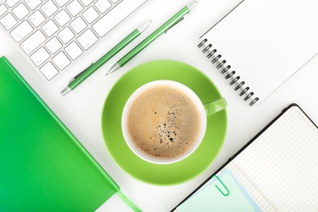 Coffee cup and office supplies. View from above. On white background photo