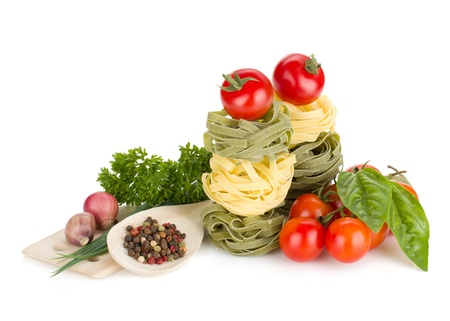 Italian food: pasta, tomatoes, fresh herbs. Isolated on white background Stock Photo