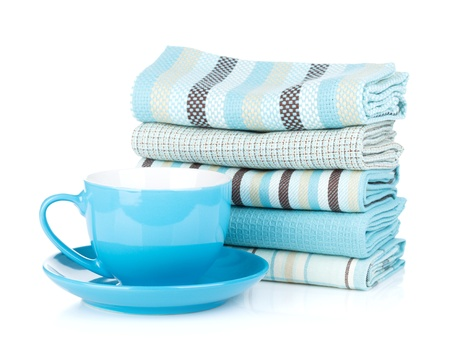Kitchen towels and blue coffee cup. Isolated on white background photo