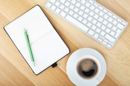 notepads: Office supplies, computer keyboard and coffee cup on wooden table