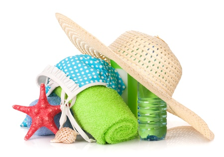 Swimming suit and beach items. Isolated on white background photo