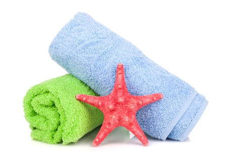 towel beach: Beach towels and starfish. Isolated on white background