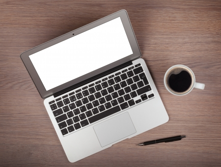 view from above: Laptop and coffee cup on wood table. View from above Stock Photo