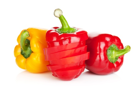 capsicums: Ripe colorful bell peppers. Isolated on white background