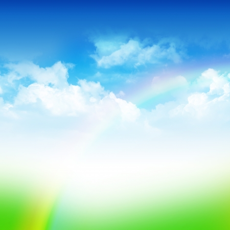 Cloudy blue sky with rainbow and green field abstract background photo