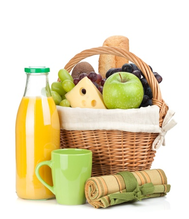 Picnic basket with bread, fruits and orange juice bottle. Isolated on white background