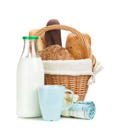 Picnic basket with bread and milk bottle. Isolated on white background photo