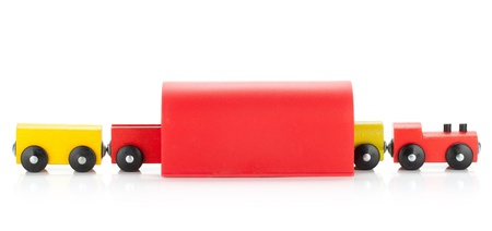 tunel: Wooden toy colored train in tunel. Isolated on white background