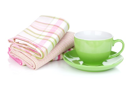 Green coffee cup and kitchen towels. Isolated on white background photo