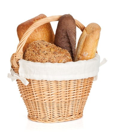 Picnic basket with various bread. Isolated on white background photo